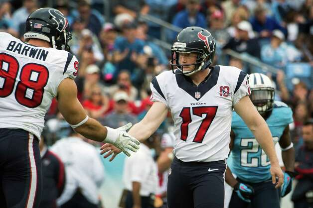 Shayne Graham gets a hand from Connor Barwin after kicking a 50-yard field goal during the third quarter. Photo: Smiley N. Pool, Houston Chronicle / © 2012  Houston Chronicle