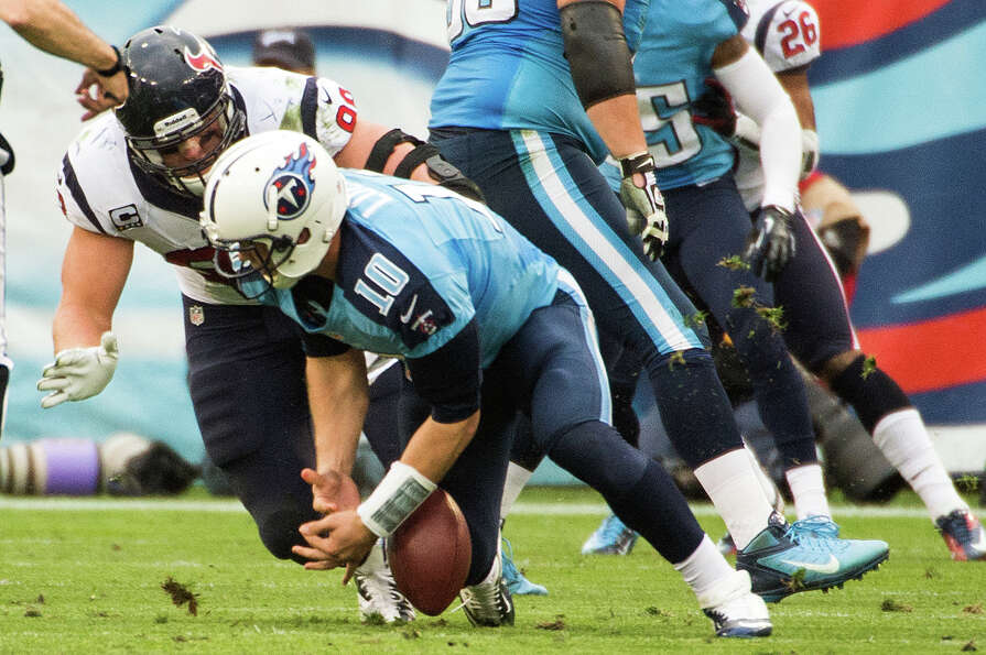 Jake Locker fumbles under pressure from J.J. Watt.