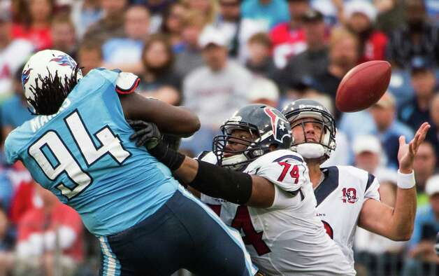 Matt Schaub catches his own pass after is was batted down by Titans defensive tackle Sen'Derrick Marks. Photo: Smiley N. Pool, Houston Chronicle / © 2012  Houston Chronicle
