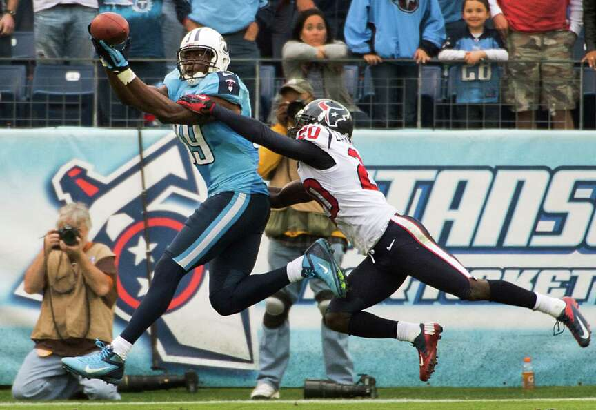 Texans defensive back Roc Carmichael breaks up a pass intended for Titans tight end Jared Cook.