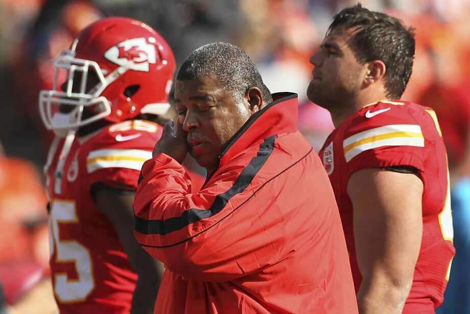 Coach Romeo Crennel wipes his eye before Sunday's game, an eventual emotional victory for a struggling Kansas City team in the wake of deadly crimes involving the Chiefs' Jovan Belcher. Photo: Colin E. Braley, Associated Press