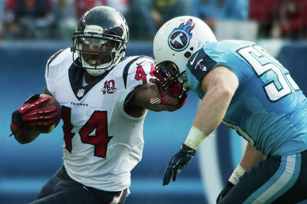 Texans running back Ben Tate tries to fend off a Titans' defender with a stiff arm. Photo: Smiley N. Pool, Houston Chronicle / © 2012  Houston Chronicle