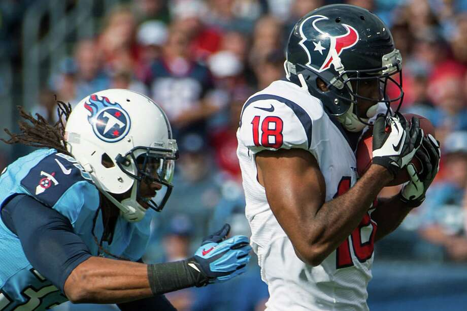 Texans wide receiver Lestar Jean beats Titans free safety Michael Griffin for a 54-yard touchdown. Photo: Smiley N. Pool, Houston Chronicle / © 2012  Houston Chronicle