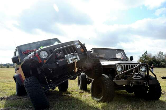 Motorcycles, Jeeps and Corvettes gathered in Beaumont on Saturday for a good cause. The 22nd Annual Buckner Toy Run brought in people from all over Southeast Texas. Former New England Patriot Devin Wyman and Santa Claus even made appearances. Participants raised money and allowed kids in need to pick the toy of their choice. After the kids opened their presents, they got to ride through the park on the motorcycles, play in the mud in the jeeps, and ride in the Corvettes at Buckner Children's Village in Beaumont on SAturday, December 1, 2012. Photo taken: Randy Edwards/The Enterprise Photo: Randy Edwards