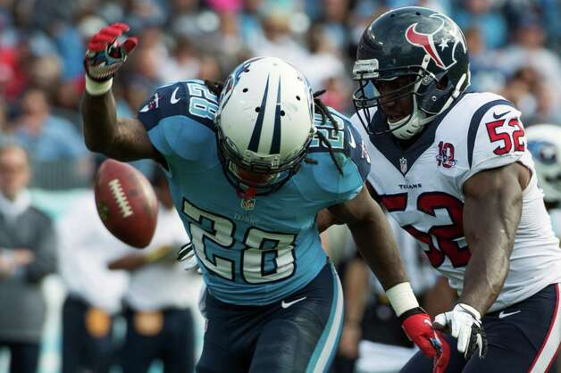 Texans inside linebacker Tim Dobbins breaks up a pass intended by Titans running back Chris Johnson during the first half. Photo: Smiley N. Pool, Houston Chronicle / © 2012  Houston Chronicle