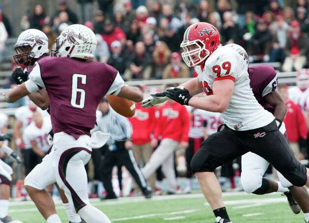 New Canaan high school defensive lineman Connor Buck chases down Windsor high school quarterback Robert Fleeting in the CIAC class L semifinal football tournament game played at Bunnell high school, Stratford, CT on Sunday December 2nd, 2012. Photo: Mark Conrad / Stamford Advocate Freelance