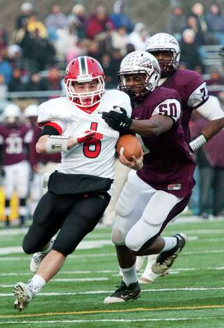 New Canaan high school quarterback Teddy Bossidy runs the ball up field in the CIAC class L semifinal football tournament game against Windsor high school played at Bunnell high school, Stratford, CT on Sunday December 2nd, 2012. Photo: Mark Conrad / Stamford Advocate Freelance