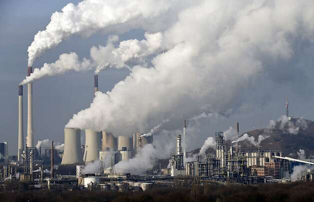 In this Dec. 16, 2009 file photo, steam and smoke rise from a coal burning power plant in Gelsenkirchen, Germany. A United Nations report on rising greenhouse gas emissions reminded world governments Wednesday, Nov. 21, 2012 that their efforts to fight climate change are far from enough to meet their stated goal of limiting global warming to 2 degrees C (3.6 F). Photo: Martin Meissner, Associated Press