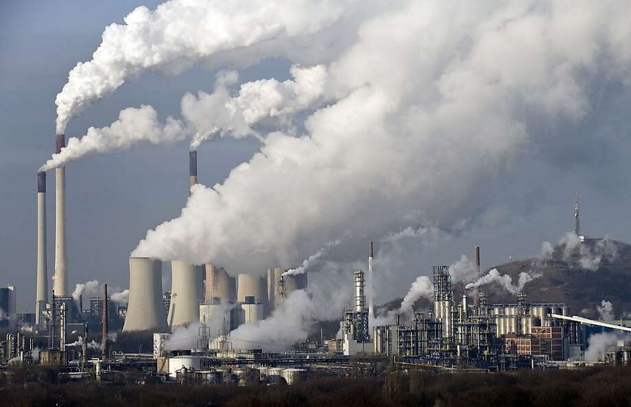 FILE - In this Dec. 16, 2009 file photo, steam and smoke rise from a coal burning power plant in Gelsenkirchen, Germany. A United Nations report on rising greenhouse gas emissions reminded world governments Wednesday, Nov. 21, 2012 that their efforts to fight climate change are far from enough to meet their stated goal of limiting global warming to 2 degrees C (3.6 F). (AP Photo/Martin Meissner, File) Photo: Martin Meissner, Associated Press