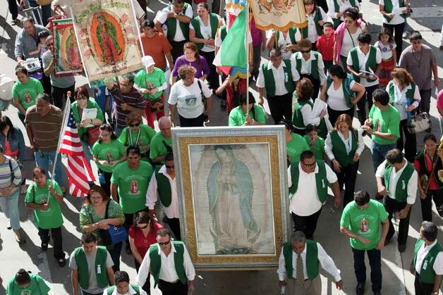 In an expression of devotion and thanksgiving to Guadalupe, the Patroness of the Americas, followers march, celebrate and dance Sunday through the streets of downtown Houston. Photo: Eric Kayne / © 2012 Eric Kayne