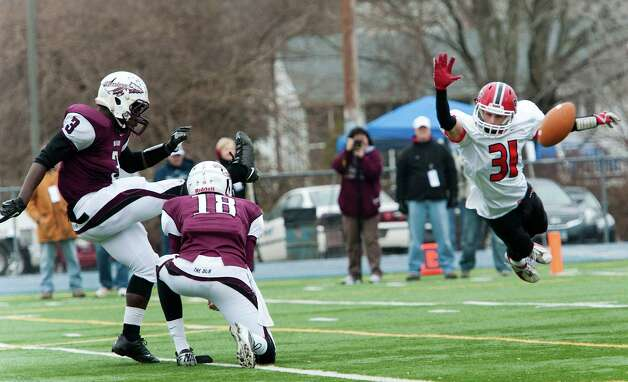 New Canaan high school's Michael DiCosmo tries to block an extra point attempt in the CIAC class L semifinal football tournament game against Windsor high school played at Bunnell high school, Stratford, CT on Sunday December 2nd, 2012. Photo: Mark Conrad / Stamford Advocate Freelance