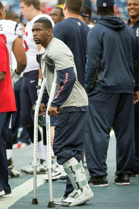 Texans cornerback Brice McCain leans on crutches for support as he watches the game in the second half after injuring his left foot. Photo: Smiley N. Pool, Staff / © 2012  Houston Chronicle