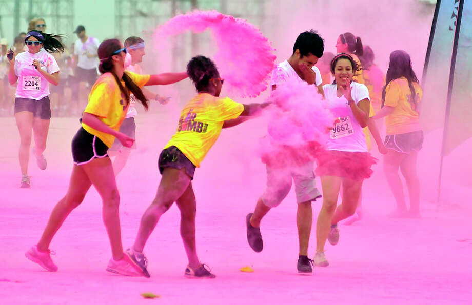 during the Color Me Rad 5K Run in the parking lot of the Freeman Coliseum. Photo: Robin Jerstad/For The Express-Ne