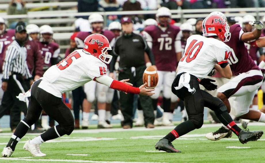 New Canaan high school quarterback Nick Cascione loses control of the ball in the CIAC class L semifinal football tournament game against Windsor high school played at Bunnell high school, Stratford, CT on Sunday December 2nd, 2012. Photo: Mark Conrad / Stamford Advocate Freelance