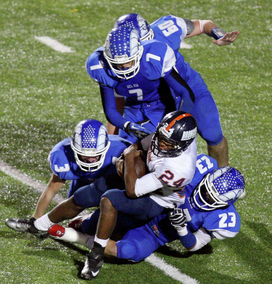 Brandeis' William Hughes is tackled by Del Rio defenders during second half action Friday Nov. 30, 2012 at Eagle Pass ISD Stadium in Eagle Pass, Tx. Brandeis won 63-7. Photo: Edward A. Ornelas, San Antonio Express-News / © 2012 San Antonio Express-News