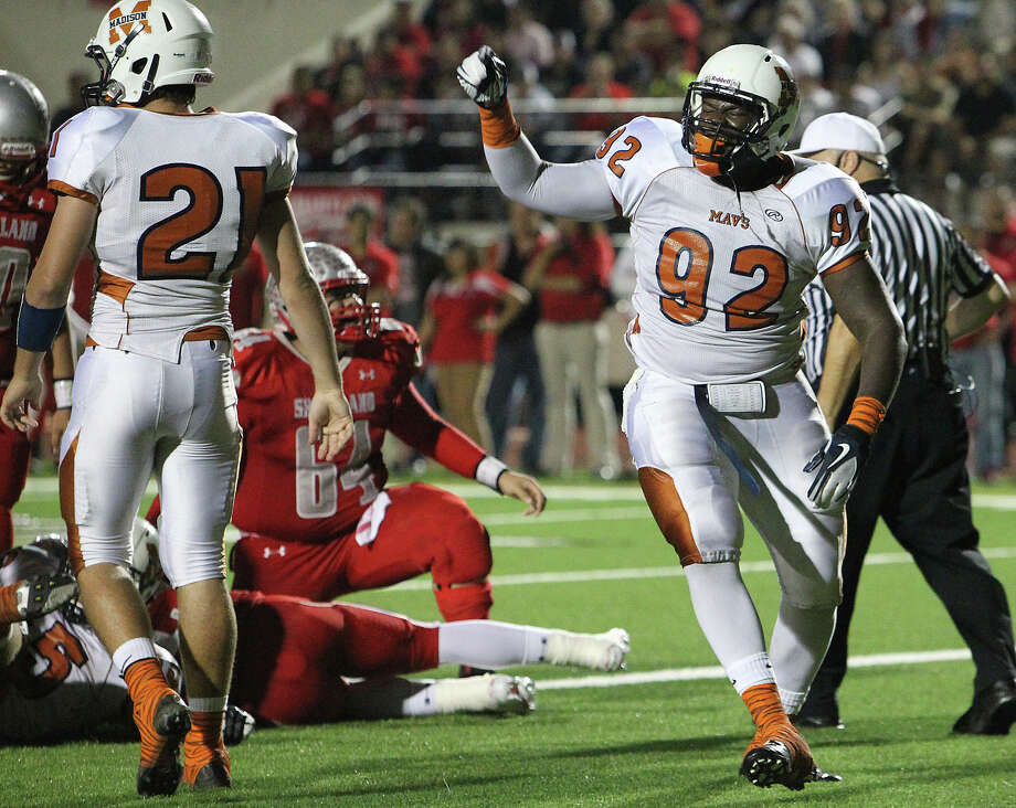 Madison's Vincent Taylor (92) reacts after sacking the Mission Sharyland quarterback for a saftey in the first half in the Class 5A Div. I playoff game in Corpus Christi on Friday, Nov. 30, 2012. Photo: Kin Man Hui, San Antonio Express-News / © 2012 San Antonio Express-News