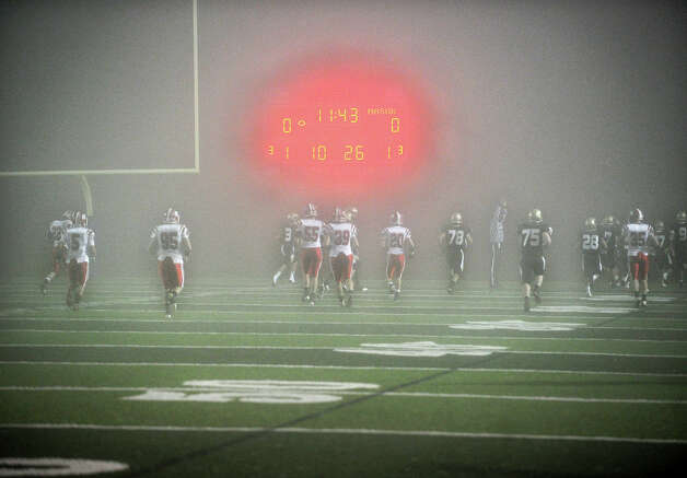 Masuk started their Class L state semifinal game against Hand in heavy fog at West Haven High School on Sunday, December 2, 2012. Masuk lost the game 42-23. Photo: Brian A. Pounds / Connecticut Post