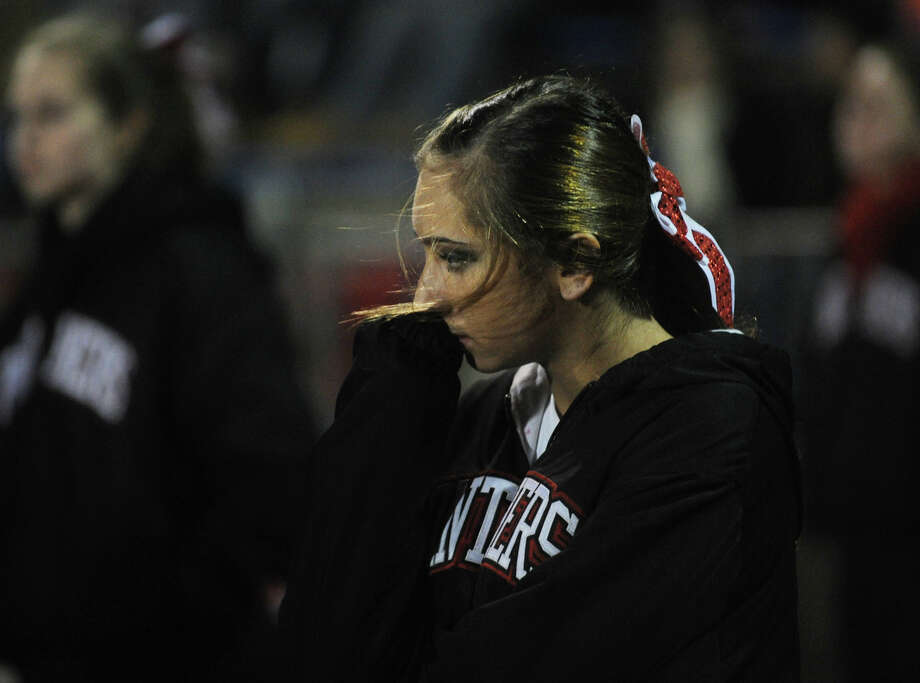 A Masuk cheerleader looks dejected as her team trailed Hand 35-0 at the end of the first half in the Class L state semifinals at West Haven High School on Sunday, December 2, 2012. Photo: Brian A. Pounds / Connecticut Post