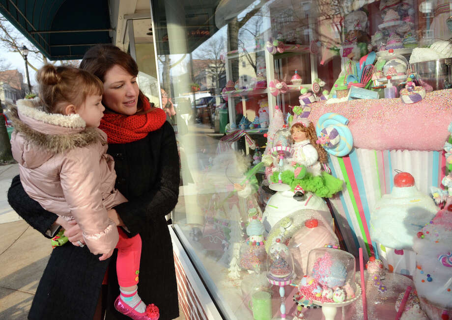 Jennifer Niznikiewicz, of Purchase, New York, and her daughter, Chloe, 3, look at the decorations in the Hoagland's of Greenwich storefront on Greenwich Avenue during the fourth annual Holiday Stroll Weekend on Sunday, Dec. 2, 2012. Photo: Amy Mortensen / Connecticut Post Freelance