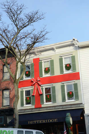 The Betteridge Jewelers on Greenwich Avenue is decorated like a giant present during the fourth annual Holiday Stroll Weekend on Sunday, Dec. 2, 2012. Photo: Amy Mortensen / Connecticut Post Freelance