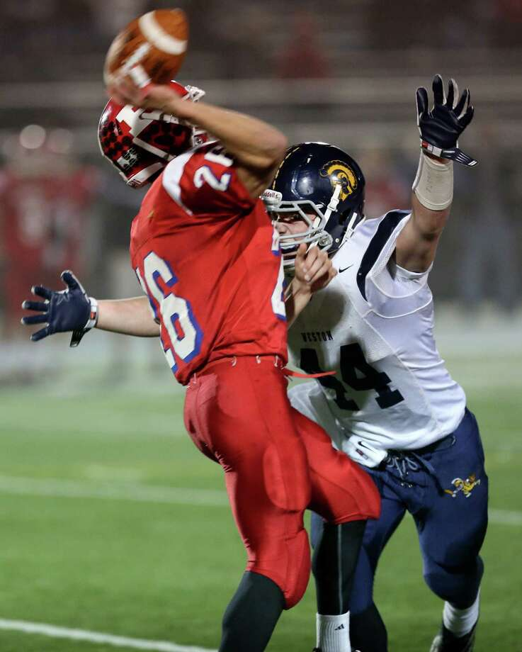 Mike Ross Connecticut Post freelance -Weston High School's # 44 Peter Lummis preasures Berlin High School's quarterback #26 Scott McLeod during first half action of the Class M semifinals. Photo: Mike Ross / Connecticut Post Freelance