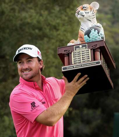 Graeme McDowell celebrates with the trophy after winning the World Challenge golf tournament at Sherwood Country Club in Thousand Oaks, Calif., Sunday, Dec. 2, 2012. (AP Photo/Bret Hartman) Photo: Bret Hartman