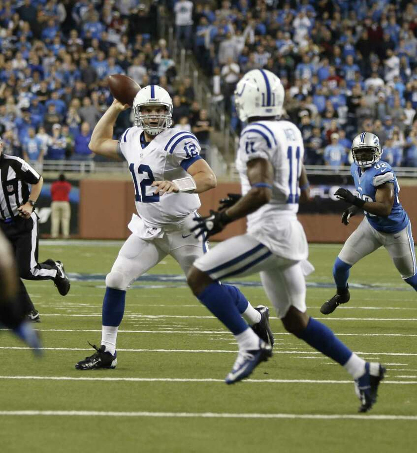 Colts rookie QB Andrew Luck (12) finds University of Houston product Donnie Avery open for a 14-yard TD pass on the game's final play, giving Indianapolis a victory over Detroit on Sunday. Photo: JULIAN H. GONZALEZ, MBR / Detroit Free Press