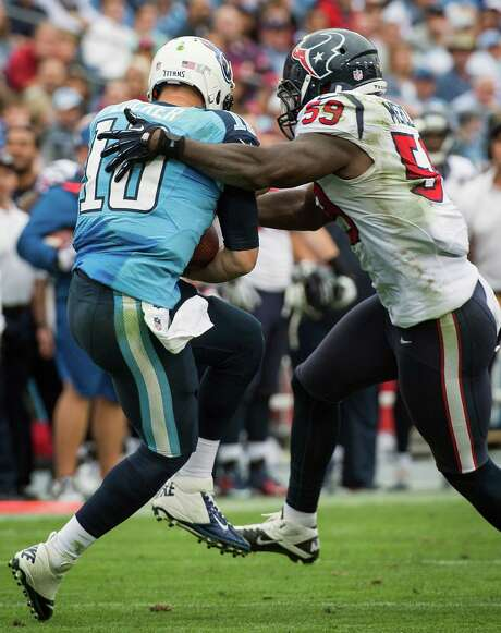 Texans linebacker Whitney Mercilus (59) introduced himself to Titans quarterback Jake Locker early and often, including on this second-half sack. Photo: Smiley N. Pool, Staff / © 2012  Houston Chronicle