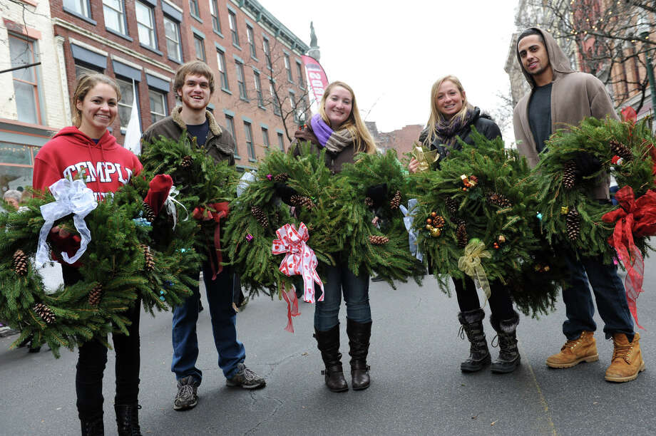 From left, Lauren Kilkenny, A.J. Bryk, Erin Bies, Amanda Peguillan and Joe Latif sell wreaths to benefit the St. Josephs Homeless Shelter during the 30th annual Victorian Stroll Sunday Dec. 2, 2012 in Troy, N.Y. (Lori Van Buren / Times Union) Photo: Lori Van Buren