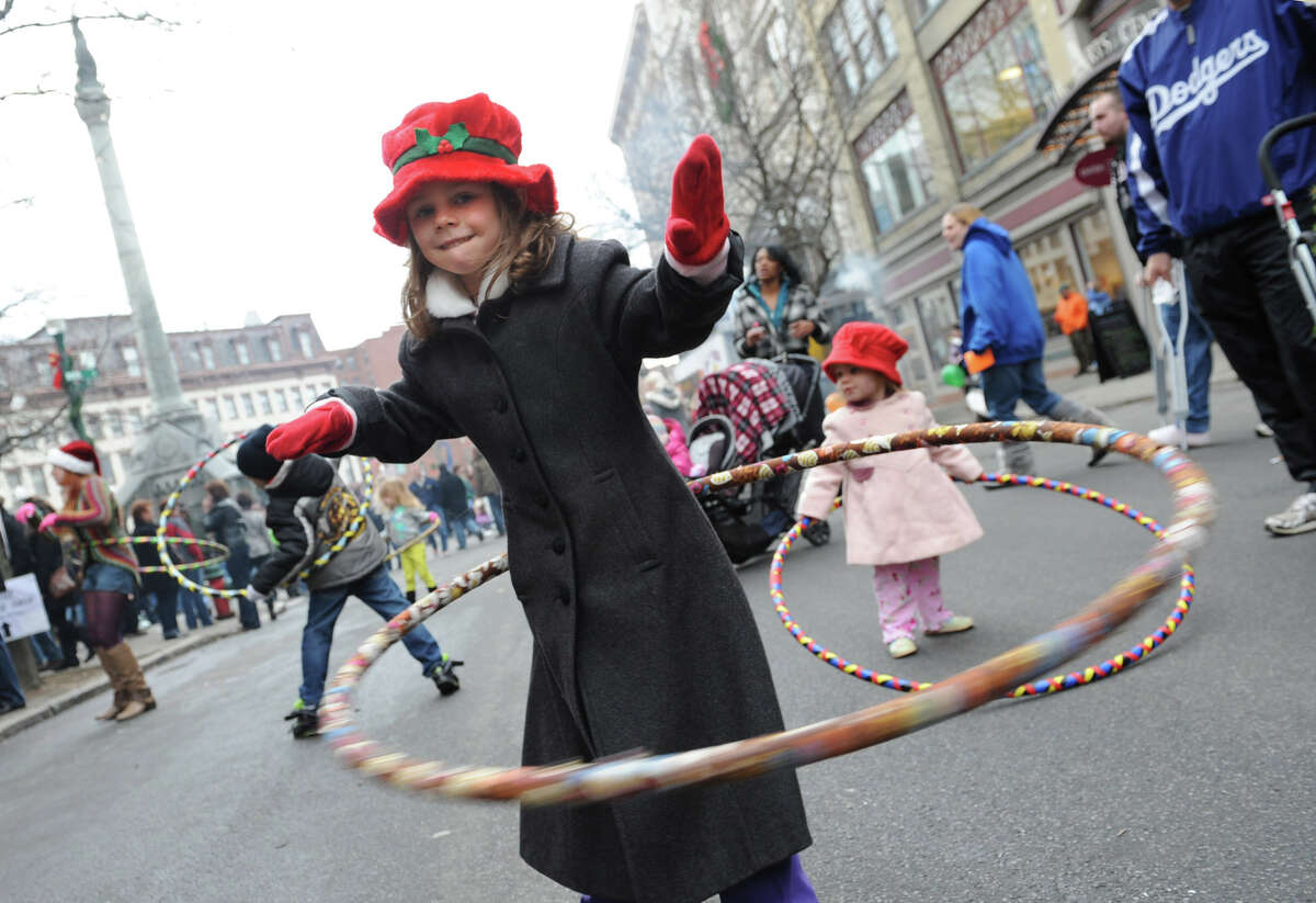 Stella Myers, 5, of Niskayuna masters the hula hoop as her sister Victoria, 1 1/2, right, tries her best during the 30th annual Victorian Stroll Sunday Dec. 2, 2012 in Troy, N.Y. (Lori Van Buren / Times Union)