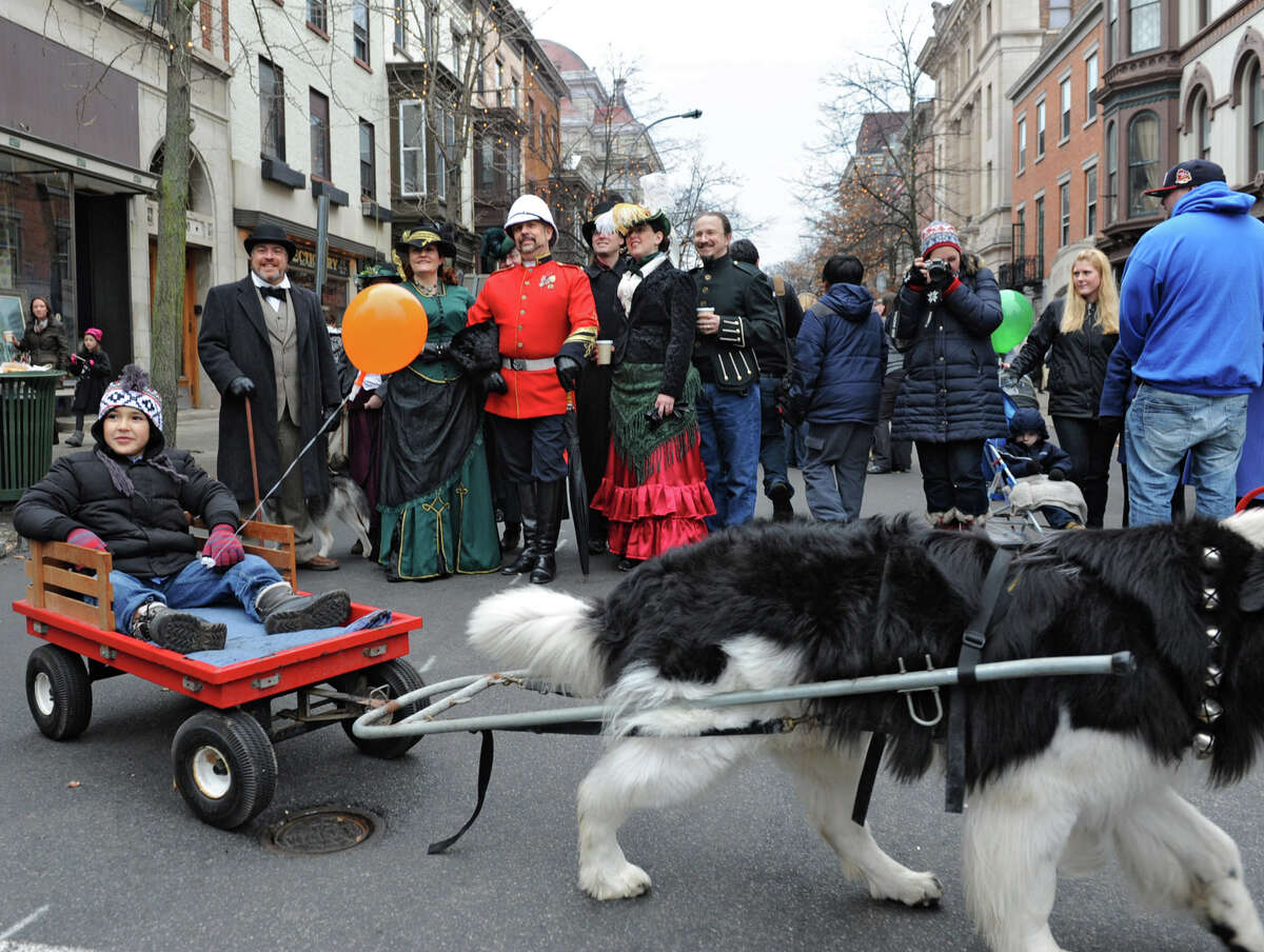 Kids get dog sled rides and people walk the street dressed in victorian costumes during the 30th annual Victorian Stroll Sunday Dec. 2, 2012 in Troy, N.Y. (Lori Van Buren / Times Union)