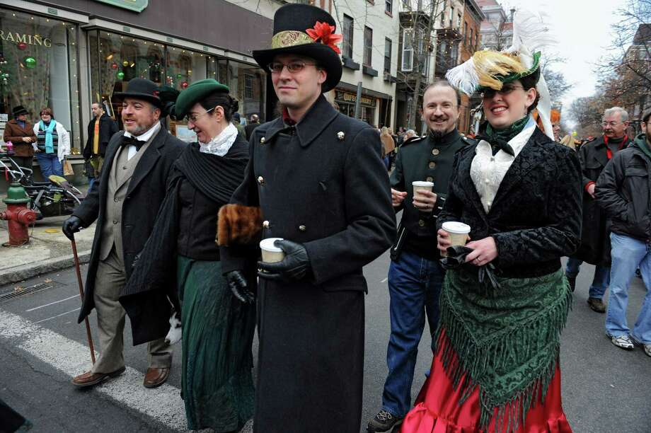 People walk the street dressed in victorian costumes during the 30th annual Victorian Stroll Sunday Dec. 2, 2012 in Troy, N.Y. (Lori Van Buren / Times Union) Photo: Lori Van Buren