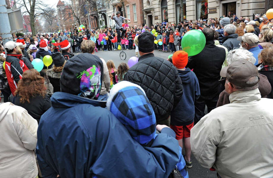 """Larry Rundle """"The Incredible Larry"""" of Glens Falls performs juggling tricks on a unicycle on Second St. during the 30th annual Victorian Stroll Sunday Dec. 2, 2012 in Troy, N.Y. (Lori Van Buren / Times Union) Photo: Lori Van Buren"""