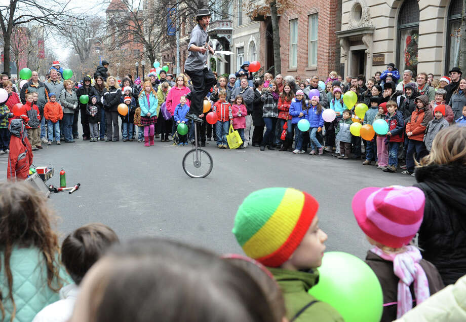 "Larry Rundle ""The Incredible Larry"" of Glens Falls performs juggling tricks on a unicycle on Second St. during the 30th annual Victorian Stroll Sunday Dec. 2, 2012 in Troy, N.Y. (Lori Van Buren / Times Union) Photo: Lori Van Buren"