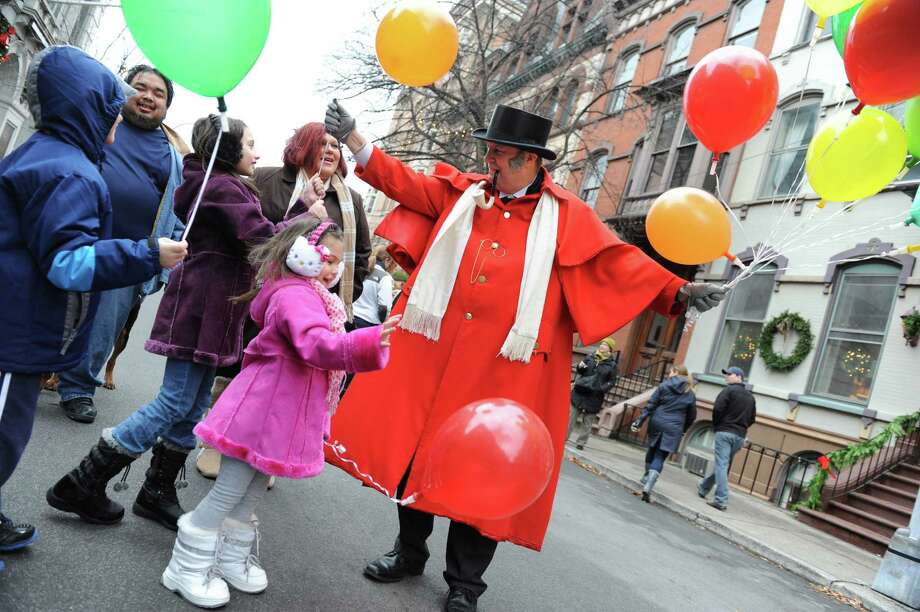 The Delamerced family from Troy gets balloons from Jim McGlynn during the 30th annual Victorian Stroll Sunday Dec. 2, 2012 in Troy, N.Y. The family from left are, Caleb Quinn, 6, Harry Delamerce, Joelyn Quinn, 9, Heather Delamerced and Olivia Delamerced, 4.  (Lori Van Buren / Times Union) Photo: Lori Van Buren