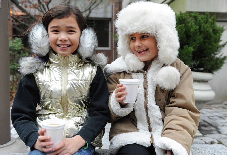 Eight year old best friends from Brunswick Hope Rheeman, left, and Lily Rodda enjoy a delicious cup of hot cocoa during the 30th annual Victorian Stroll Sunday Dec. 2, 2012 in Troy, N.Y. (Lori Van Buren / Times Union) Photo: Lori Van Buren