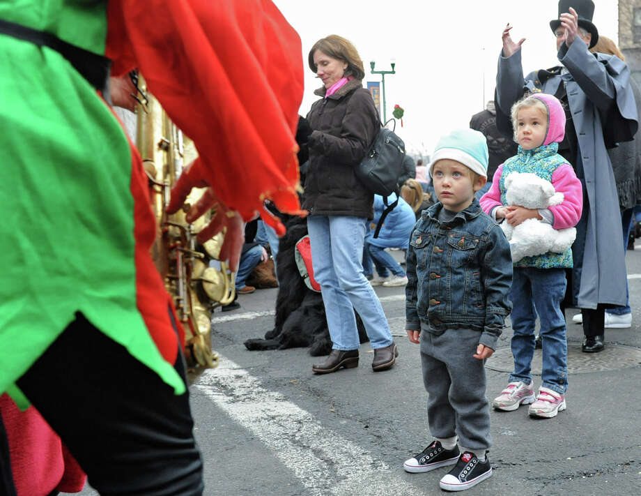 Lucian Murphy, 3, of Waterford is mesmerized by Santa and an elf play saxaphones during the 30th annual Victorian Stroll Sunday Dec. 2, 2012 in Troy, N.Y. (Lori Van Buren / Times Union) Photo: Lori Van Buren