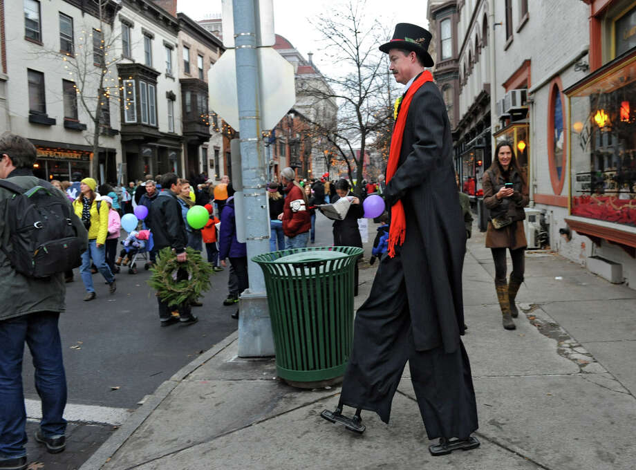 A man on stilts walks the streets in a victorian costume during the 30th annual Victorian Stroll Sunday Dec. 2, 2012 in Troy, N.Y. (Lori Van Buren / Times Union) Photo: Lori Van Buren