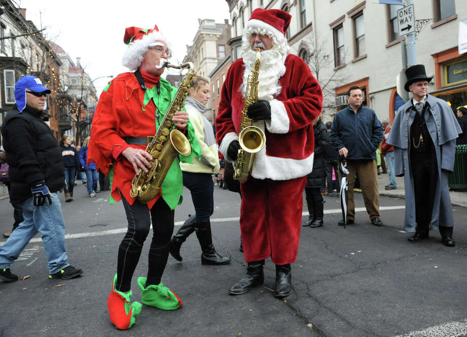 Santa and an elf play saxaphones during the 30th annual Victorian Stroll Sunday Dec. 2, 2012 in Troy, N.Y. (Lori Van Buren / Times Union) Photo: Lori Van Buren