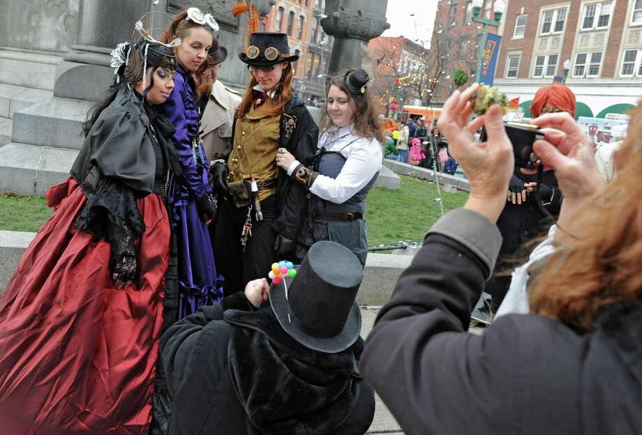 People take photos of people in victorian costumes during the 30th annual Victorian Stroll Sunday Dec. 2, 2012 in Troy, N.Y. (Lori Van Buren / Times Union) Photo: Lori Van Buren