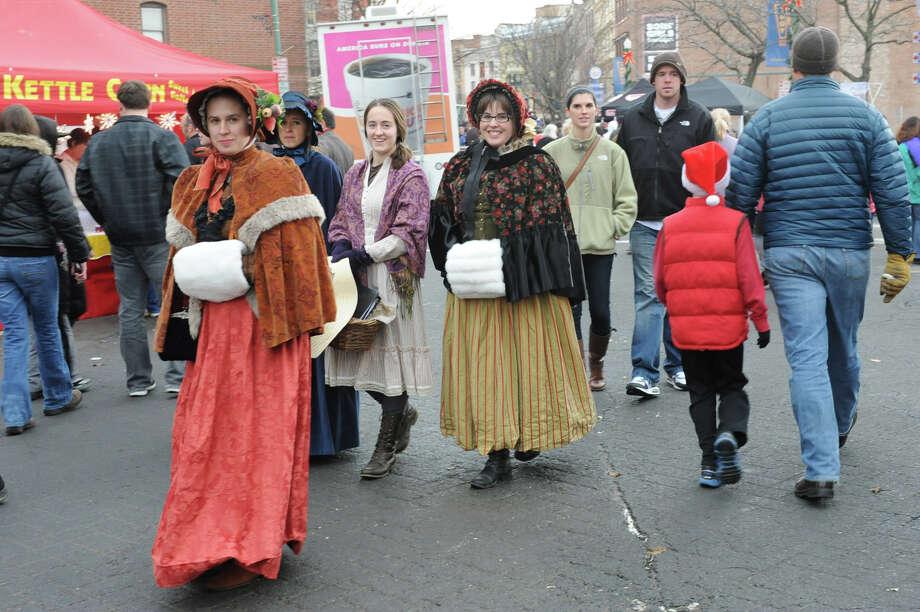 People walk the street dress in victorian costumes during the 30th annual Victorian Stroll Sunday Dec. 2, 2012 in Troy, N.Y. (Lori Van Buren / Times Union) Photo: Lori Van Buren