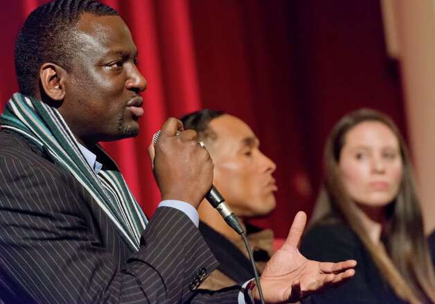 "Yusef Salaam answers questions from the audience following a screening of the documentary film ""The Central Park Five"" at the Avon Theatre, Stamford, CT on Sunday December 2nd 2012. Yusef and Korey Wise (center) are two of the Central Park Five featured in the film which was directed by Ken Burns and his daughter Sarah Burns (right). Photo: Mark Conrad / Stamford Advocate Freelance"