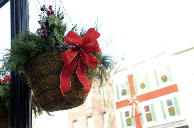 A festive basket hangs from a light post on Greenwich Avenue during the fourth annual Holiday Stroll Weekend on Sunday, Dec. 2, 2012. Photo: Amy Mortensen / Connecticut Post Freelance