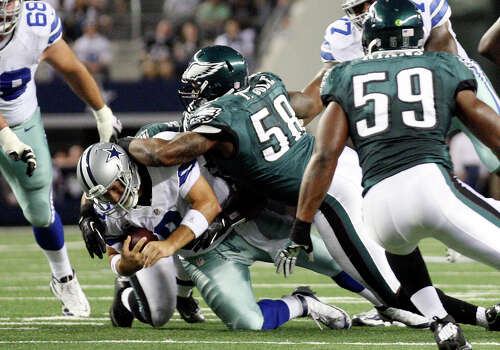 Dallas Cowboys' quarterback Tony Romo is sacked by Philadelphia Eagles' defensive ends Brandon Graham, (54), and Trent Cole, (58), during the first half at Cowboys Stadium in Arlington, Texas, Sunday, Dec. 2, 2012. Photo: Jerry Lara, San Antonio Express-News / © 2012 San Antonio Express-News