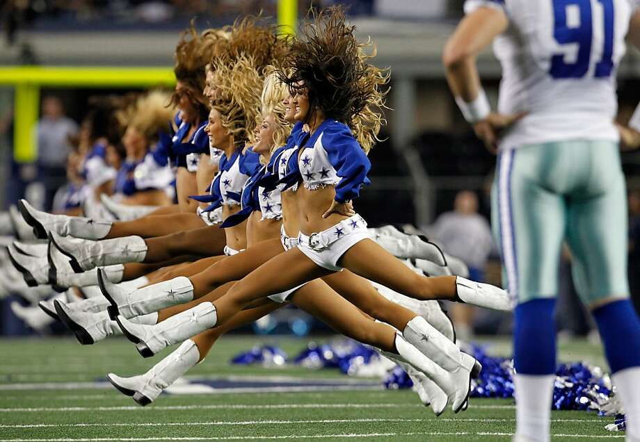 The Dallas Cowboys Cheerleaders perform before the Dallas Cowboys take on the Philadelphia Eagles at Cowboys Stadium on December 2, 2012 in Arlington, Texas.  (Photo by Tom Pennington/Getty Images) Photo: Tom Pennington, Getty Images