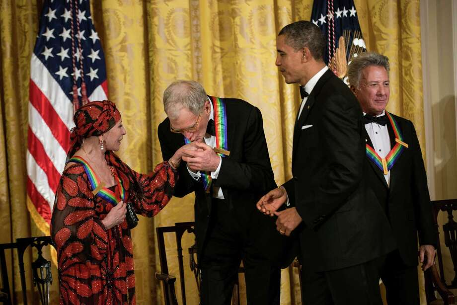 President Barack Obama watches as David Letterman kisses fellow Kennedy Center honoree Natalia Makarova's hand Sunday evening at an event with actor Dustin Hoffman and other honorees at the White House. Photo: BRENDAN SMIALOWSKI, Staff / 2012 Brendan Smialowski