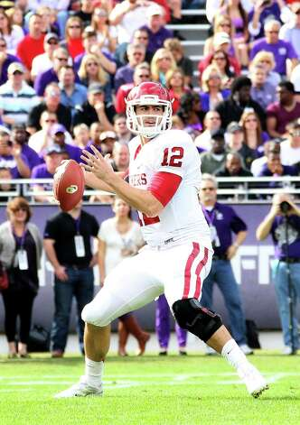 OU quarterback Landry Jones might have thought he would not have to face A&M again after the Aggies left for the SEC. Photo: R. Yeatts, Getty Images / 2012 Getty Images