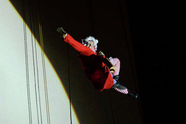 Mrs. Claus joins Santa, Rudolph, Brian Cashman, Bobby Valentine and friends as she drops down the side of the Landmark Building in a holiday rappelling celebration in downtown Stamford, CT on Dec. 2, 2012. Photo: Shelley Cryan / Shelley Cryan for the Stamford Advocate/ freelance Shelley Cryan