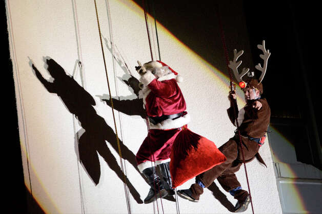 Santa and Rudolph rappel down the side of the Landmark Building in downtown Stamford, CT. They joined Bobby Valentine, Brian Cashman and Mrs. Claus in a holiday rappelling celebration on Dec. 2, 2012. Photo: Shelley Cryan / Shelley Cryan for the Stamford Advocate/ freelance Shelley Cryan