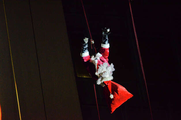 Santa does a flip as he rappels down the side of the Landmark Building in downtown Stamford, CT. He joined Bobby Valentine, Brian Cashman, Rudolph and Mrs. Claus in a holiday rappelling celebration on Dec. 2, 2012. Photo: Shelley Cryan / Shelley Cryan for the Stamford Advocate/ freelance Shelley Cryan